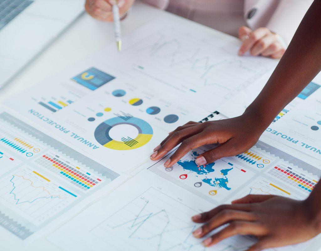 Closeup shot two businesswomen analysing graphs in an office