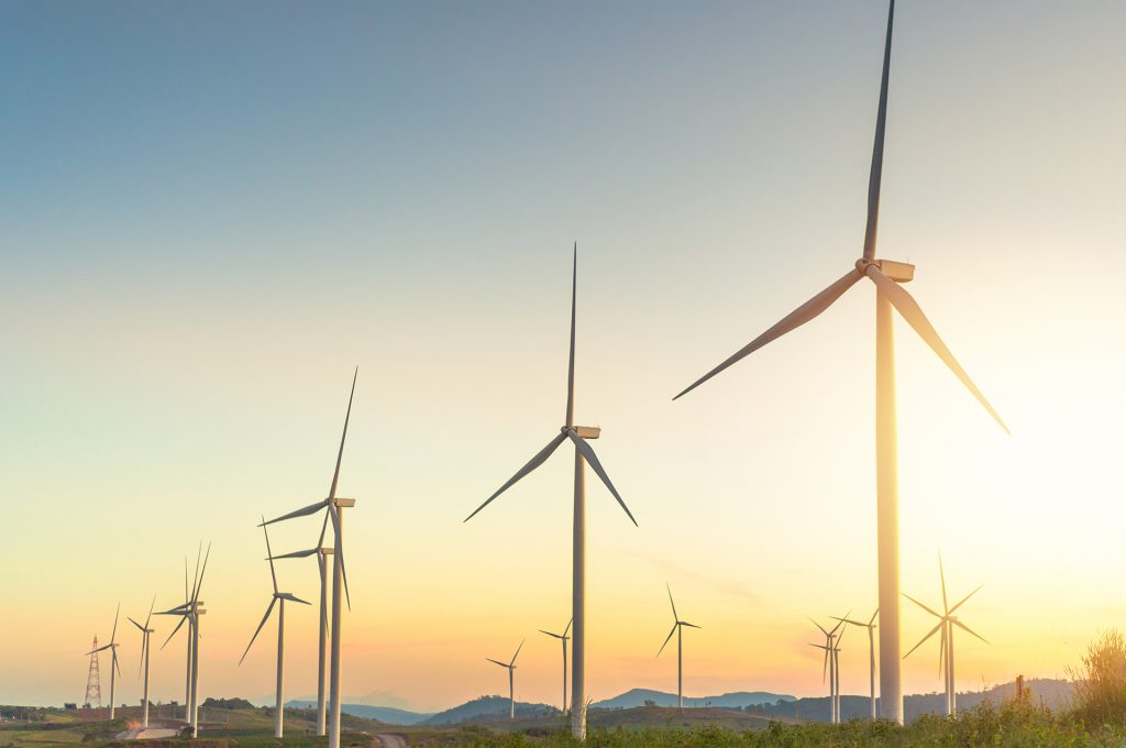 Wind turbine replace old coal power plant with high voltage electricity power line for clean energy